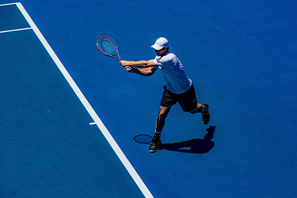 roger federer playing tennis field
